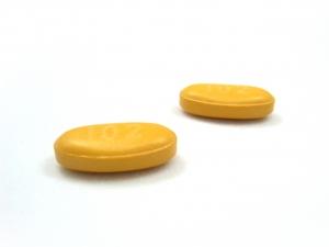 Желтая овальня таблетка для секса